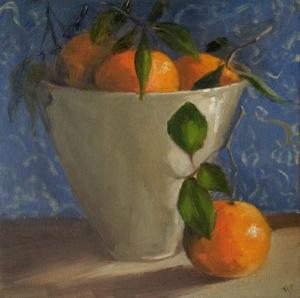 Tangerines in white bowl