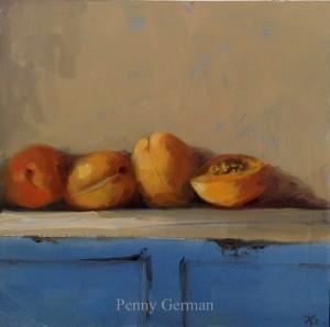1614 apricots on a blue dresser