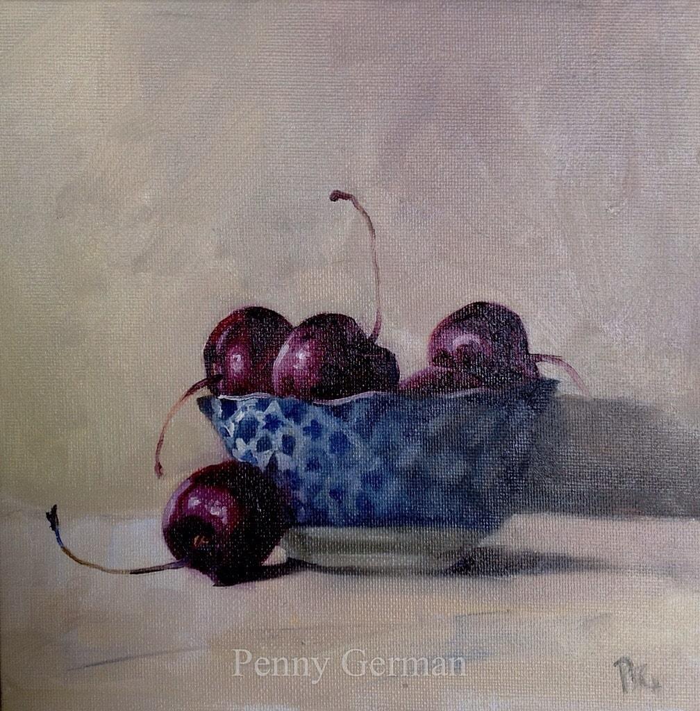 1880 cherries in blue dish